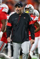 Ohio State football coach Ryan Day filled the two vacancies on his staff by staying in-house with Corey Dennis as his new quarterbacks coach and bringing back familiar face Kerry Coombs as co-defensive coordinator and secondary coach