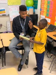Aspire Hanley Elementary School teacher Earl Wilson with student Jadon Knox.