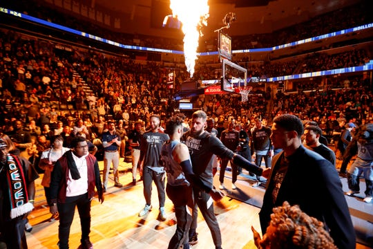 Grizzlies' Dillon Brooks (24) chest bumps Jonas Valanciunas during player introductions Monday, Jan. 20, 2020, before a game against the Pelicans at the FedExForum in downtown Memphis.