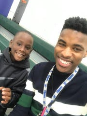 Aspire Hanley Elementary School teacher Earl Wilson poses with student Jadon Knox.