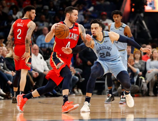 Grizzlies' Dillon Brooks (24) guards Pelicans' JJ Redick (4) on Monday, Jan. 20, 2020, during a game at the FedExForum in downtown Memphis.