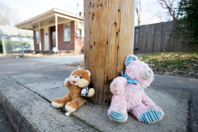 Stuffed animals are leaned against a utility pole Tuesday, Jan. 21, 2020, across the street from the scene of a shooting in the 700 block of Josephine Street in Memphis. Jadon Knox, 10, was killed in the shooting.