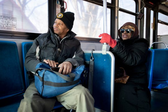 Dennis Ray and Angel Anderson talk Tuesday, Jan. 21, 2020, while riding the route 42 Memphis Area Transit Authority bus in Memphis.