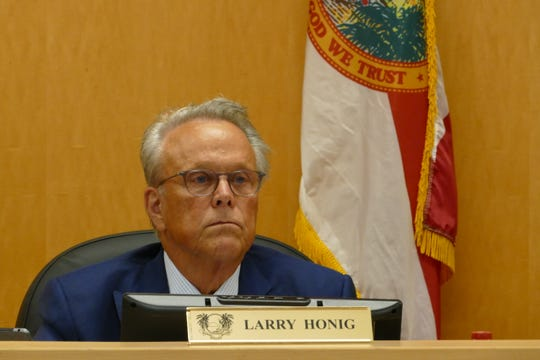 Larry Honig, Marco Island City Council member, listens to local resident Regina Dayton during a meeting on Jan. 21.