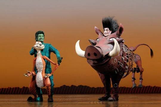 "Nick Cordileone (as Timon) and Ben Lipitz (as Pumbaa) perform in Disney's ""The Lion King."""