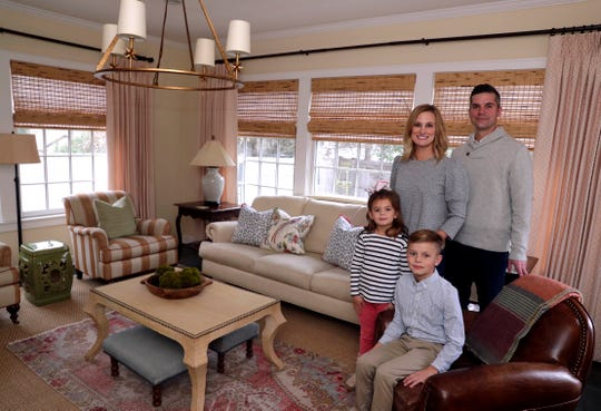 The Posnanski family gathers in the family room, with colors inspired by a pillow with birds on it. The print has pinks, purples, greens, blues and taupes. Meghan is an interior designer, her husband is Tim, and the children are Jack, 8, and Norah, 6.