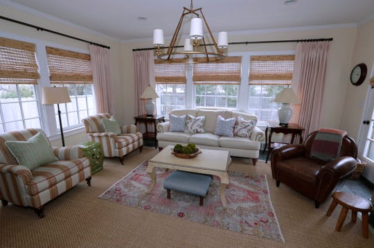 The family room at the  Posnanski home features layers of color and texture with small items for visual appeal.