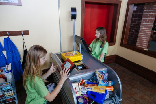 Pretend play is part of the appeal of children's museums. At the Children's Museum of La Crosse, children can pretend to shop or work at Kwik Trip.