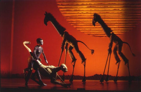 "A cheetah and giraffes perform in Disney's ""The Lion King."""