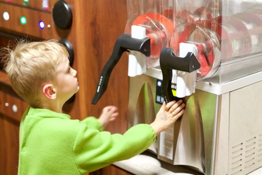 At the Kwik Trip exhibit in the Children's Museum of La Crosse, kids can pretend to get their own coffee and drinks, as well as stock shelves and check out items.