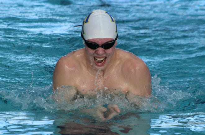 Mountain Home's Micah Cruse competes in a breaststroke event on Saturday at Batesville.