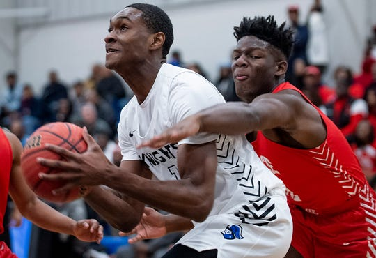 Lee's Jakel Williams (12) defends against Catholic's Justin Bufford (1 at the Catholic campus in Montgomery, Ala., on Monday January 20, 2020.