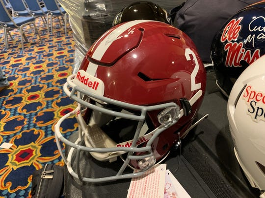 "A look at the Alabama side of the customized Crimson helmet that former Alabama and Oklahoma quarterback Jalen Hurts will wear in Saturday's Senior Bowl game in Mobile. The other side has the Sooners' ""OU"" logo."
