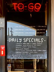 The daily specials (side dishes) are posted at the walk-up order window.