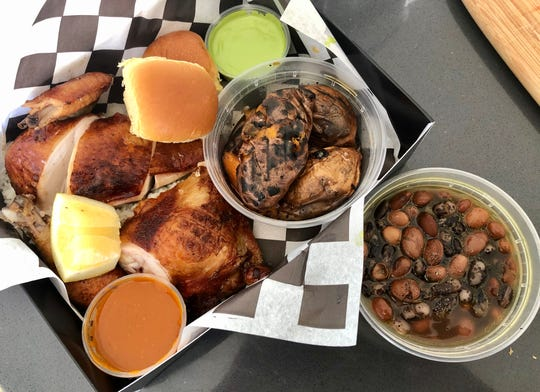 Our BokBox lunch included half a coal-roasted chicken over rice, soft rolls, roasted fingerling sweet potatoes with hot honey and lemon, Aji Verde and Bok sauces, and heirloom beans.
