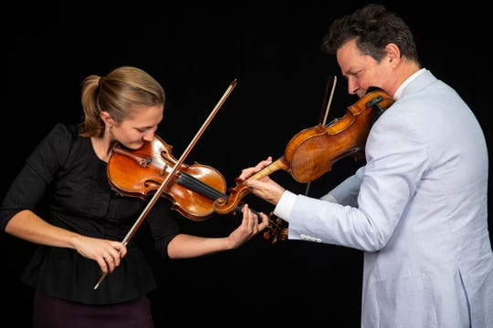 Naples Philharmonic Co-Concertmaster Emerson Millar, left, and Concertmaster Glenn Basham, right, play their violins on Friday, January 17, 2020.