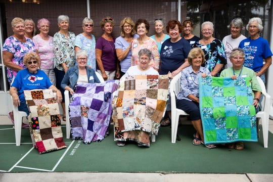 The women in Patrecia Ross's quilt-making group pose for a portrait with some of their quilts at Corkscrew Woodlands in Estero on Friday, January 17, 2020.