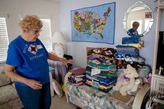 Patrecia Ross points to the stacks of quilts in various stages of completion at her home at Corkscrew Woodlands in Estero on Friday, January 17, 2020. Ross's late husband, Joseph L. Ross, was a B-17 bombardier in the South Pacific for four years during WWII.