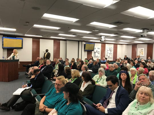 Residents, many dressed in green and opposing a proposed rural village on the edges of Golden Gate Estates, attend a workshop about a rural growth plan, Tuesday, Jan. 21, 2020, at the Collier County commission chambers.