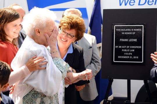 Ellen Leone becomes emotional as Oakland Mayor Linda Schwager, right, looks on after the unveiling of the plaque dedicating the Oakland Post Office to Ellen's late husband Frank Leone on Thursday, April 25, 2019.