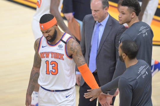 Jan 20, 2020; Cleveland, Ohio, USA; New York Knicks forward Marcus Morris Sr. (13) reacts after an injury in the third quarter against the Cleveland Cavaliers at Rocket Mortgage FieldHouse. Mandatory Credit: David Richard-USA TODAY Sports