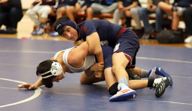 "Jacob ""Bobo"" Mendoza (top) will lead the Deming High Wildcat wrestlers against the Socorro Warriors at 6 p.m. on Wednesday."