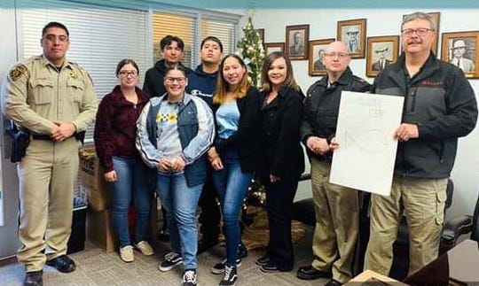 Deming Cesar Chavez Charter High School staff, support team and Familia treated local law enforcement with donuts and a card of appreciation. DCCCHS students are pictured with, from left, Luna County Sheriff's Office Captain Jose Martinez, Capt. Michael Brown and LCSO Sheriff Kelly Gannaway.