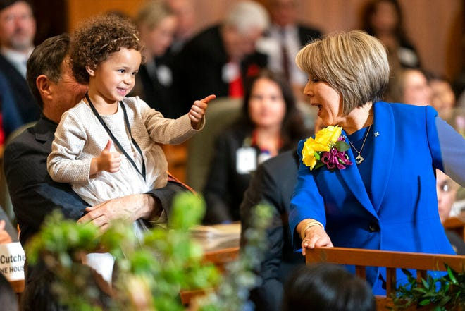 New Mexico Gov. Michelle Lujan Grisham gets a thumbs up from granddaughter Avery Stewart during the State of the State address opening the New Mexico legislative session in the house chambers at the state Capitol in Santa Fe, N.M. on Tuesday, Jan. 21, 2020.