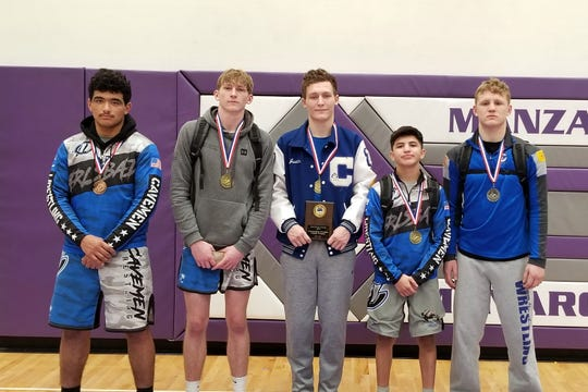 Left to right: Carlsbad wrestlers Jared Dunez (190), Mason Box (152), Justin Wood (160), Marcus Najera (106) and Trystan Rogers (182) display their medals won at the 2020 Joe Vivian Tournament at Manzano High in Albuquerque on Jan. 20.