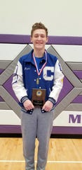 "Carlsbad's Justin Wood displays his first-place medal in the 160-pound division and a plaque for ""Most Outstanding Wrestler"" in the middleweight divisions after claiming the 2020 Joe Vivan Tournament. Wood won the Joe Vivian Tournament all five years of his eligibility."