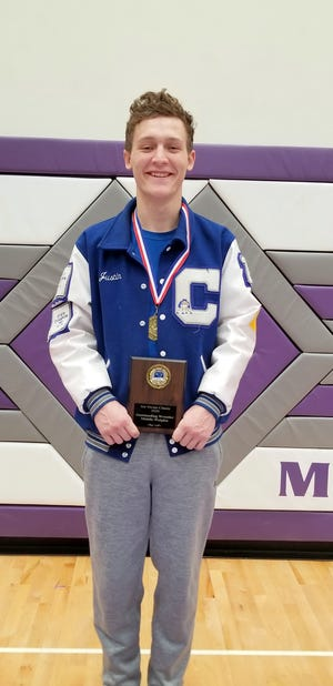 """Carlsbad's Justin Wood displays his first-place medal in the 160-pound division and a plaque for """"Most Outstanding Wrestler"""" in the middleweight divisions after claiming the 2020 Joe Vivan Tournament. Wood won the Joe Vivian Tournament all five years of his eligibility."""