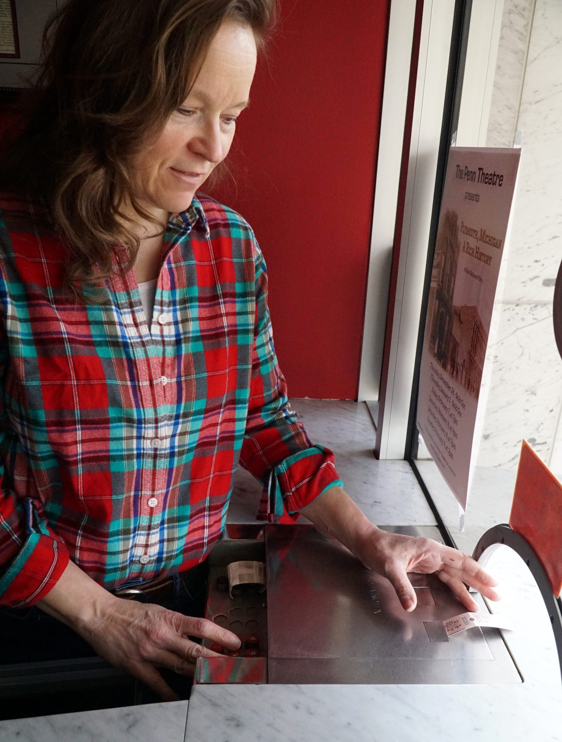 Ellen Elliott punches a couple of tickets out of the WWII-era AutoMaticket machine.