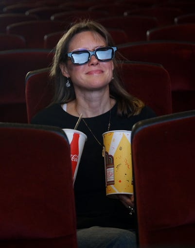 Debra Neil takes a seat in the South Lyon Theater sporting a pair of 3-D glasses. The South Lyon can show 3-D movies with tickets costing only $2 more than the usual $5-6 cost.