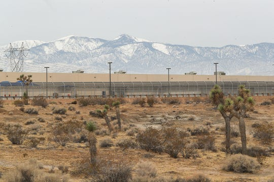 The U.S. Immigration and Customs Enforcement's Adelanto Processing Center sits surrounded by Joshua Trees and open desert in Adelanto, Caif., on Dec. 3, 2019.