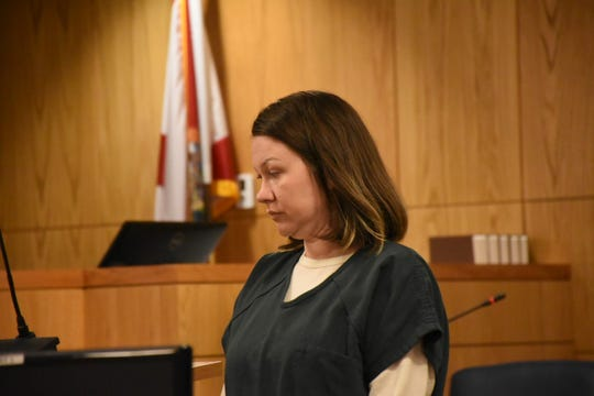 Candie Lynn Walker, 35, appears Tuesday before Circuit Court Judge Stephen Pitre at her sentencing hearing.