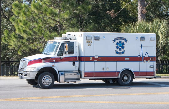 An EMS vehicle returns to the Escambia County Public Safety Building in Pensacola on Tuesday, Jan. 21, 2020.
