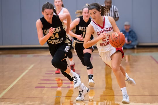 Bermudian Springs' Bailey Oehmig drives down court to score as Delone Catholic's Maggie Hughes (34) gives chase in the third quarter of a YAIAA Division III game in York Springs Monday, Jan. 20, 2020.