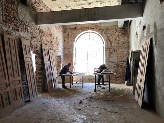 Construction workers in Guaymas work to restore a historic building built in 1904 to its original glory. It will become a bank and apartments.