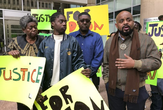 The Rev. Jarrett Maupin (from right) holds a press conference outside of Phoenix City Hall with Dion Humphrey's father, William Humphrey, Dion's younger brother Richous Humphrey and Dion's grandmother Marjorie Janvier (left) in Phoenix on Jan. 21, 2020. Dion Humphrey was shot with a rubber bullet and tackled to the ground by Phoenix Police Department when he was mistaken for a robbery suspect.