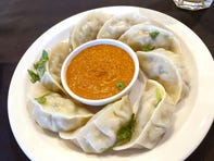 Traditional momo with steamed dumplings with fire roasted tomato sauce at Sherpa Kitchen in Gilbert.