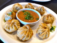 Kothey momo with fried dumplings and fire roasted tomato sauce at Sherpa Kitchen in Gilbert.
