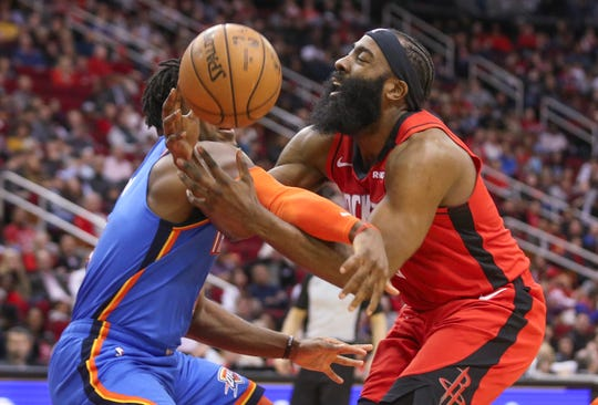 Houston Rockets guard James Harden (13) is fouled by Oklahoma City Thunder guard Luguentz Dort (5) in the second quarter at Toyota Center. Harden and Dort are Sun Devils. They both went to Arizona State.