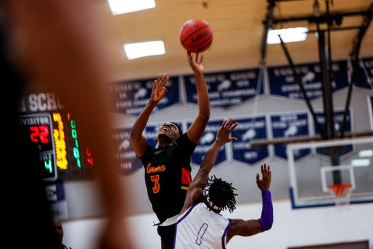 Corona del Sol High School Eric Blackwell (3) shoots against Cesar Chavez High School guard Tyraill Carrethers (1) during the first half of the Corona del Sol High School vs. Cesar Chavez High School game in the Martin Luther King Jr. Classic at Tempe High School Monday, Jan. 20, 2020.