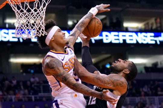 Phoenix Suns forward Kelly Oubre Jr. (3) blocks the shot on San Antonio Spurs center LaMarcus Aldridge during the first half of an NBA basketball game Monday, Jan. 20, 2020, in Phoenix. (AP Photo/Rick Scuteri)