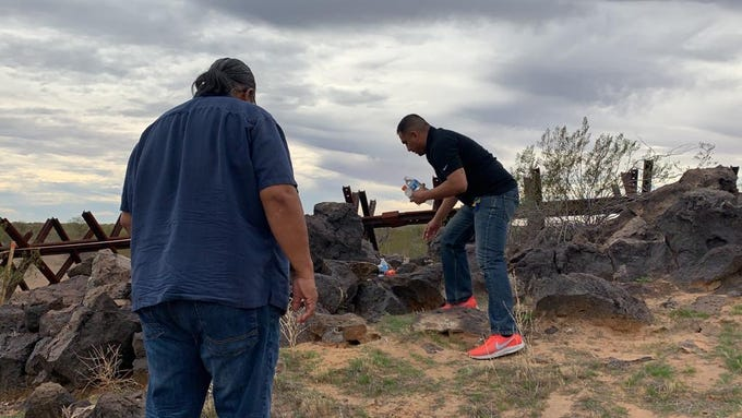 Jessie Navarro leaves offerings of food and water at an unnamed O'Odham burial site that stands on the path of border wall construction, on Jan. 20, 2020.