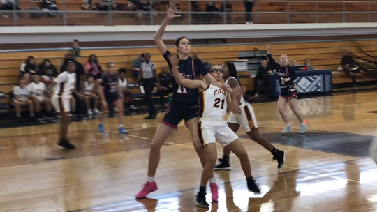 Jan. 20, 2020; Pinnacle center Kennedy Basham towers over Mountain Pointe guard Jayden Young in the low post in the MLK Dream Classic basketball showcase at Tempe High School