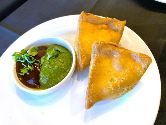 Samosas filled with seasoned potatoes, peas and carrots with mint and tamarind chutneys at Sherpa Kitchen in Gilbert.