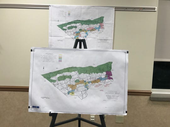 The proposed zoning map (front) and the current zoning map (back). The proposed ordinance as it's currently written would change some agricultural land into industrial or commercial land.