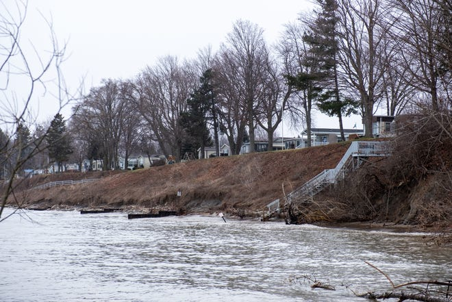 Waves from Lake Huron lap along the coastline in a Lexington neighborhood Thursday, Jan. 16, 2020.