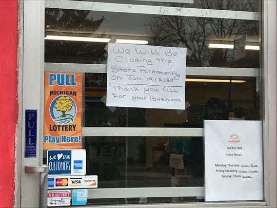 A sign hanging on the door of Krazy Larry'z at 8216 Lakeshore Road in Worth Township on Jan. 16, 2020.